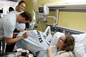 The Bryan Brothers and Aryna Sabalenka sign a shirt for Baptist Children's Hospital patient, Danielle, 19