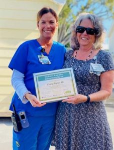 Fisherman's Community Hospital Chief Nursing Officer Cheryl Cottrell, R.N., presented Cheryl Signor, R.N., with the hospital's first DAISY Award