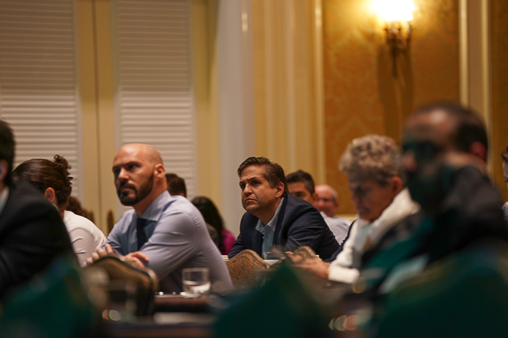 Attendees listen intently at the Inaugural Miami Cancer Institute Summit of the Americas on Immunotherapies for Hematologic Malignancies
