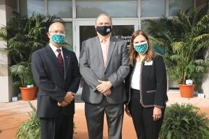 Dr. Jose Vazquez, Mayor Juan Carlos Bermudez and Nancy Batista-Rodriguez at Baptist Health Downtown Doral Opening